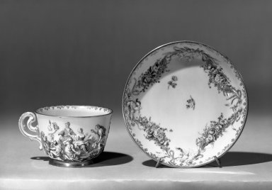 Capo di Monte. <em>Cup & Saucer</em>, ca. 1760. Porcelain, cup: 2 1/2 x 3 1/4 in. (6.4 x 8.3 cm). Brooklyn Museum, Gift of the Estate of Emily Winthrop Miles, 64.82.45a-b. Creative Commons-BY (Photo: Brooklyn Museum, 64.82.45a-b_acetate_bw.jpg)