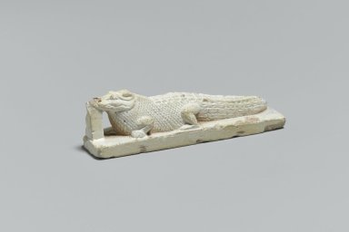 <em>Crocodile Figure</em>, 305 B.C.E.-395 C.E. Faience, 3/4 x 11/16 x 2 5/8 in. (1.9 x 1.7 x 6.7 cm). Brooklyn Museum, Charles Edwin Wilbour Fund, 65.134.1. Creative Commons-BY (Photo: Brooklyn Museum, 65.134.1_threequarterleft_PS2.jpg)