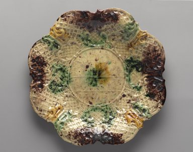 American. <em>Plate</em>, ca. 1770. Glazed earthenware, 7/8 x 9 7/8 in. (2.2 x 25.1 cm). Brooklyn Museum, H. Randolph Lever Fund, 65.144.4. Creative Commons-BY (Photo: Brooklyn Museum, 65.144.4_front_PS9.jpg)