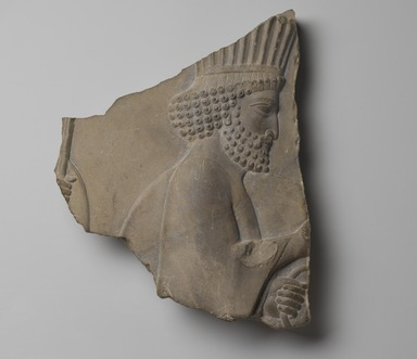 Ancient Near Eastern. <em>A Persian Guard</em>, 5th-4th century B.C.E. Limestone, 10 1/2 x 9 x 1 7/8 in. (26.6 x 22.8 x 4.7 cm). Brooklyn Museum, Gift of the Kevorkian Foundation in memory of Hagop Kevorkian, 65.195. Creative Commons-BY (Photo: Brooklyn Museum, 65.195_view1_PS2.jpg)