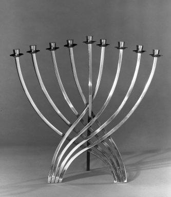 Ludwig Wolpert. <em>Hanukah Menorah, Candle Holder</em>, ca. 1962. Brass, 11 x 11 3/8 in. (27.9 x 28.9 cm). Brooklyn Museum, Gift of Dr. Abram Kanof, 65.198. Creative Commons-BY (Photo: Brooklyn Museum, 65.198_acetate_bw.jpg)