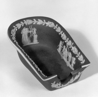 Josiah Wedgwood & Sons Ltd. (founded 1759). <em>Ashtray or Pipe Holder</em>, ca. 1907. Jasperware, 2 1/8 x 3 1/2 in. (5.4 x 8.9 cm). Brooklyn Museum, Gift of Dr. and Mrs. William R. Liberman in honor of Mrs. George Liberman, 65.200.2. Creative Commons-BY (Photo: Brooklyn Museum, 65.200.2_bw.jpg)