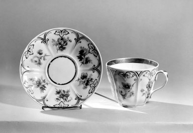 Charles Cartlidge & Co. (1848-1856). <em>Cup and Saucer</em>, ca. 1850. Porcelain, Cup (a): 3 1/2 x 5 3/8 x 4 1/2 in. (8.9 x 13.7 x 11.4 cm). Brooklyn Museum, Gift of Mrs. Henry W. Patten, 65.201.1a-b. Creative Commons-BY (Photo: Brooklyn Museum, 65.201.1a-b_acetate_bw.jpg)