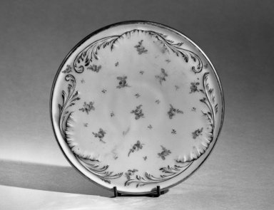 Dresden. <em>Hot Plate Holder</em>, ca. 1900. Porcelain, 1/2 x 6 3/8 in. (1.3 x 16.2 cm). Brooklyn Museum, Anonymous gift, 66.111.15. Creative Commons-BY (Photo: Brooklyn Museum, 66.111.15_acetate_bw.jpg)