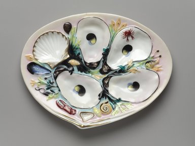 Thomas C. Smith (American, 1815-1901). <em>Oyster Plate</em>, patented January 4, 1881. Porcelain, 3/4 x 8 5/8 x 6 5/8 in. (1.9 x 21.9 x 16.8 cm). Brooklyn Museum, H. Randolph Lever Fund, 66.182. Creative Commons-BY (Photo: Brooklyn Museum, 66.182_PS9.jpg)