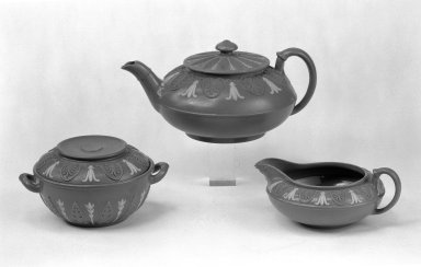 Josiah Wedgwood & Sons Ltd. (founded 1759). <em>Three-Piece Tea Set Consisting of Teapot with Cover, Sugar Bowl with Cover and Creamer</em>, ca.1850. Drabware with lilac and white relief decoration, teapot: 3 3/4 x 5 1/2 in. (9.5 x 14 cm). Brooklyn Museum, Gift of the Bess and Sam Zeigen Family, 66.229.11a-e. Creative Commons-BY (Photo: Brooklyn Museum, 66.229.11a-c_bw.jpg)