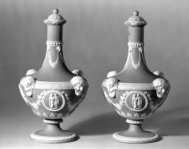 Josiah Wedgwood & Sons Ltd. (founded 1759). <em>Barber Bottle with Lid, One of Pair</em>, ca. 1830. Blue jasperware, 10 x 5 in. (25.4 x 12.7 cm). Brooklyn Museum, Gift of the Bess and Sam Zeigen Family, 66.229.8a-b. Creative Commons-BY (Photo: Brooklyn Museum, 66.229.8a-d_bw.jpg)