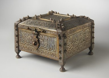 <em>Mamluk-Style Lidded Casket with Qur'anic Inscriptions</em>, 19th-20th century. Copper alloy, engraved and inlaid with silver, H. (including legs): 6 in. (15.2 cm). Brooklyn Museum, Gift of Ruth Friedman, 66.24.13. Creative Commons-BY (Photo: Brooklyn Museum, 66.24.13_three_quarter_PS11.jpg)