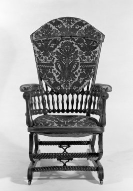 George Jacob Hunzinger (American, born Germany, 1835-1898). <em>Platform Rocking Armchair</em>, Patented September 26, 1882 and April 3, 1888. Wood, modern upholstery, metal, 42 11/16 x 26 x 30 in. (108.5 x 66 x 76.2 cm). Brooklyn Museum, Gift of Mrs. Darwin R. James III, 66.26. Creative Commons-BY (Photo: Brooklyn Museum, 66.26_bw.jpg)