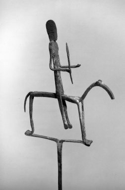 Bamana. <em>Staff with Equestrian Figure</em>, late 19th-early 20th century. Iron, pigment, accumulated materials, 29 7/8 x 8 x 1in. (75.9 x 20.3 x 2.5cm). Brooklyn Museum, Frederick Loeser Fund, 66.8. Creative Commons-BY (Photo: Brooklyn Museum, 66.8_acetate_bw.jpg)