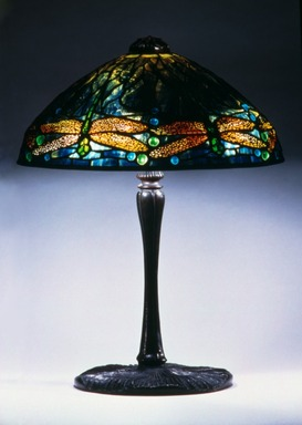 "Clara Driscoll (American, born St. Mary's, Texas, 1881-1945). <em>""Dragonfly"" Lamp</em>, ca. 1900-1920. Glass, bronze, and lead, 18 1/4 x 14 x 14 in. (46.4 x 35.6 x 35.6 cm). Brooklyn Museum, Bequest of Laura L. Barnes, 67.120.54. Creative Commons-BY (Photo: Brooklyn Museum, 67.120.54.jpg)"
