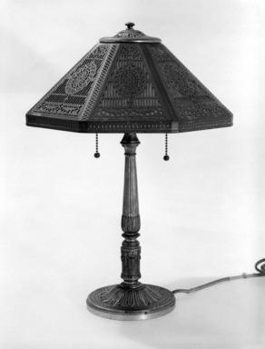 Tiffany Studios (1902-1932). <em>Lamp</em>, ca. 1910. Gilded brass, glass, 17 3/4 x 13 x 13 in. (45.1 x 33 x 33 cm). Brooklyn Museum, Bequest of Laura L. Barnes, 67.120.55. Creative Commons-BY (Photo: Brooklyn Museum, 67.120.55_bw.jpg)