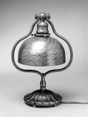 Tiffany Studios (1902-1932). <em>Lamp</em>, ca. 1910. Glass, matted bronze, 13 1/8 x 9 3/8 x 7 1/8 in. (33.3 x 23.8 x 18.1 cm). Brooklyn Museum, Bequest of Laura L. Barnes, 67.120.56. Creative Commons-BY (Photo: Brooklyn Museum, 67.120.56_bw.jpg)