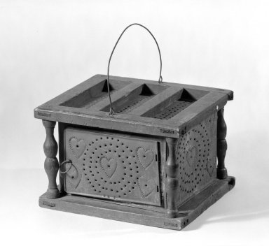 American. <em>Footwarmer</em>, ca. 1780. Tin and Butternut (?), 5 3/4 x 9 x 7 3/4 in. (14.6 x 22.9 x 19.7 cm). Brooklyn Museum, Gift of Mr. and Mrs. Henry Sherman, 67.128.24. Creative Commons-BY (Photo: Brooklyn Museum, 67.128.24_bw.jpg)