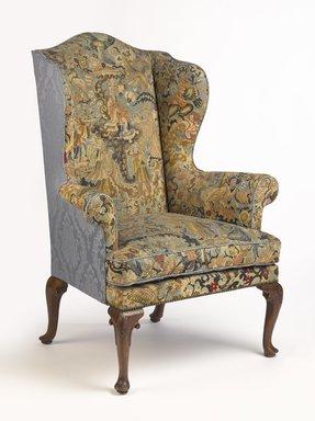 <em>Wing Chair</em>, ca. 1710. Walnut, needlework, 48 x 35 1/4 x 30 in. (121.9 x 89.5 x 76.2 cm). Brooklyn Museum, Gift of Mrs. H. A. Metzger, 67.197.9a-b. Creative Commons-BY (Photo: Brooklyn Museum, 67.197.9a-b_PS9.jpg)