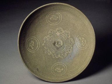 <em>Bowl</em>, last half of the 13th-first half of the 14th century. Stoneware with celadon glaze, Height: 2 3/8 in. (6 cm). Brooklyn Museum, Gift of Paul E. Manheim, 67.199.11. Creative Commons-BY (Photo: Brooklyn Museum, 67.199.11.jpg)