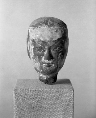 <em>Head of a Woman</em>, 3rd-2nd century B.C.E. Terra cotta, grey clay., 3 1/2 x 2 1/4 in. (8.9 x 5.7 cm). Brooklyn Museum, Gift of Paul E. Manheim, 67.199.20. Creative Commons-BY (Photo: Brooklyn Museum, 67.199.20_bw.jpg)