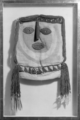 <em>Mask for Mummy Bundle</em>. Cotton, silver?, wool, feathers, 14 3/4 in. (37.5 cm). Brooklyn Museum, Gift of Jack Lenor Larsen, 67.240.1. Creative Commons-BY (Photo: Brooklyn Museum, 67.240.1_bw.jpg)