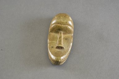 Loma. <em>Personal Miniature Mask</em>, late 19th-early 20th century. Stone, 4 1/8 x 1 15/16 x 1 1/2 in. (10.5 x 5 x 3.8 cm). Brooklyn Museum, Bequest of Laura L. Barnes, 67.25.33. Creative Commons-BY (Photo: Brooklyn Museum, 67.25.33_front_PS5.jpg)