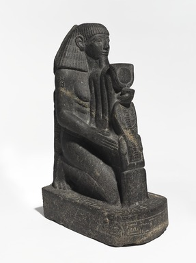 <em>Senenmut</em>, ca. 1478-1458 B.C.E. Granodiorite with granite vein, 18 3/4 × 7 × 11 1/2 in., 67.5 lb. (47.6 × 17.8 × 29.2 cm, 30.62kg). Brooklyn Museum, Charles Edwin Wilbour Fund, 67.68. Creative Commons-BY (Photo: , 67.68_threequarter_left_PS9.jpg)