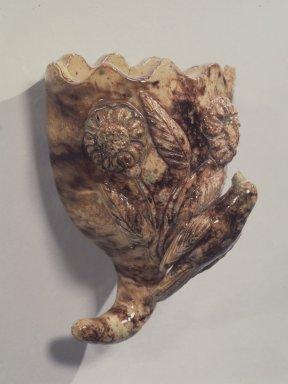 Anthony Wise Baecher (American, 1824-1889). <em>Wall Pocket</em>, ca. 1860. Glazed earthenware, 6 1/4 x 4 1/8 in. (15.9 x 10.5 cm). Brooklyn Museum, H. Randolph Lever Fund, 67.78. Creative Commons-BY (Photo: Brooklyn Museum, 67.78.jpg)