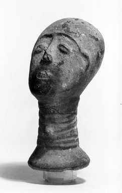 Akan. <em>Funerary Portrait Head</em>, late 19th or early 20th century. Buffware, reduced-fired, encrustation, wood, height: 6 3/8 in. (16.3 cm). Brooklyn Museum, Caroline A.L. Pratt Fund, 68.10.1. Creative Commons-BY (Photo: Brooklyn Museum, 68.10.1_threequarter_bw.jpg)