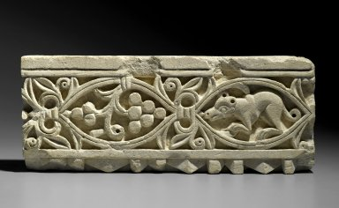 Coptic. <em>Plant Scroll Enclosing Grapes and an Animal</em>, 5th-6th century C.E. Limestone, 7 × 17 11/16 × 7 1/4 in. (17.8 × 45 × 18.4 cm). Brooklyn Museum, Charles Edwin Wilbour Fund, 68.150.2. Creative Commons-BY (Photo: Brooklyn Museum, 68.150.2_PS2.jpg)