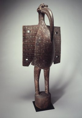 Senufo. <em>Figure of a Hornbill  (Kporopyan)</em>, early 20th century. Wood, paint, oil, 68 1/16 x 28 x 22 1/2 in.  (172.9 x 71.1 x 57.2 cm). Brooklyn Museum, Gift of Rosemary and George Lois, 68.159.1. Creative Commons-BY (Photo: Brooklyn Museum, 68.159.1.jpg)