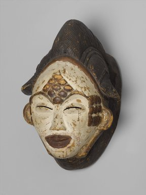 Punu. <em>Mask for the Okuyi Society (Mukudj)</em>, late 19th century. Wood, pigment, metal, 12 × 8 1/2 × 7 1/4 in. (30.5 × 21.6 × 18.4 cm). Brooklyn Museum, Gift of Mr. and Mrs. Milton Lowenthal through The Roebling Society, 68.160. Creative Commons-BY (Photo: Brooklyn Museum, 68.160_PS2.jpg)
