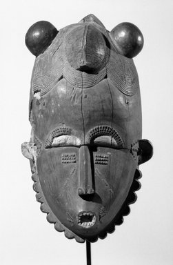 Baule. <em>Portrait Mask (ndoma)</em>, late 19th-early 20th century. Wood, pigment, height: 38.6 cm. Brooklyn Museum, Gift of Rosemary and George Lois, 68.218.1. Creative Commons-BY (Photo: Brooklyn Museum, 68.218.1_front_bw.jpg)