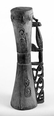 Asmat. <em>Hourglass Shaped Drum</em>. Carved wood, lizard skin head, 3 3/4 x 2 7/8 x 10 1/4 in. (9.5 x 7.3 x 26 cm). Brooklyn Museum, Gift of Mr. and Mrs. Stanley Ross, 68.220.1. Creative Commons-BY (Photo: Brooklyn Museum, 68.220.1_bw.jpg)