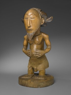 Hemba. <em>Standing Male Figure (Sigiti)</em>, late 19th century. Carved, stained lightwood, incised, polished, woven reed, 17 3/4 x 8 x 8 in. (45.1 x 20.3 x 20.3 cm). Brooklyn Museum, Gift of the Florence and Carl L. Selden Foundation, 68.32. Creative Commons-BY (Photo: Brooklyn Museum, 68.32_PS2.jpg)