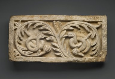 Coptic. <em>Recarved Plant Scroll with Snakes and Bird Heads</em>, Ancient, recut in the 20th century C.E. Limestone, 10 1/16 x 20 1/16 x 4 1/4 in. (25.5 x 51 x 10.8 cm). Brooklyn Museum, Charles Edwin Wilbour Fund, 68.3. Creative Commons-BY (Photo: Brooklyn Museum, 68.3_PS1.jpg)
