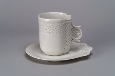 Union Porcelain Works (1863-ca. 1922). <em>Cup and Saucer</em>, ca. 1876. Porcelain, (a) Cup: 3 1/16 x 3 5/8 x 3 1/16 in. (7.8 x 9.2 x 7.8 cm). Brooklyn Museum, Gift of Franklin Chace, 68.87.50a-b. Creative Commons-BY (Photo: Brooklyn Museum, 68.87.50a-b.jpg)