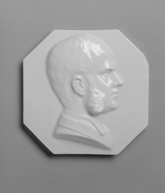 Attributed to Karl L. H. Mueller (American, born Germany, 1820-1887). <em>Plaque, Portrait of Charles H. L. Smith</em>, late 19th century. Porcelain, diameter: 5 3/4 in. (14.6 cm). Brooklyn Museum, Gift of Franklin Chace, 68.87.56. Creative Commons-BY (Photo: Brooklyn Museum, 68.87.56_bw.jpg)