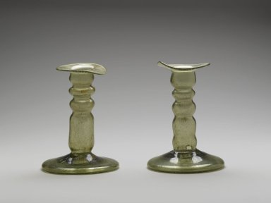 <em>One Candlestick with Circular Base</em>, 9th century. Glass, 5 3/8 x 3 7/8 in. (13.7 x 9.8 cm). Brooklyn Museum, Gift of Mr. and Mrs. Charles K. Wilkinson, 69.121.3. Creative Commons-BY (Photo: , 69.121.3_70.6.1_PS1.jpg)