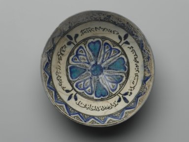 "<em>""Sultanabad"" Bowl</em>, 14th century. Black, cobalt blue, and turquoise glaze on white ground., 3 3/4 x 7 3/4 x 2 5/8 in. (9.5 x 19.7 x 6.6 cm). Brooklyn Museum, Gift of Mr. and Mrs. Charles K. Wilkinson, 69.121.5. Creative Commons-BY (Photo: Brooklyn Museum, 69.121.5_PS2.jpg)"