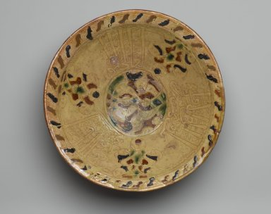 <em>Bowl with Arabic Inscription in Thuluth Script</em>, mid-14th century. Ceramic; earthenware, with incised decoration through a white slip and painted with brown and green pigments under a transparent amber glaze, 4 3/4 x 13 1/16 in. (12 x 33.2 cm). Brooklyn Museum, Henry L. Batterman Fund, A. Augustus Healy Fund, Frank Sherman Benson Fund and Ella C. Woodward Memorial Fund, 69.122.2. Creative Commons-BY (Photo: Brooklyn Museum, 69.122.2_PS2.jpg)