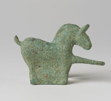 <em>Belt Hook in the Shape of a Horse</em>, 3rd century. Bronze with green patination, 2 3/8 x 3 5/8 in.  (6.0 x 9.2 cm). Brooklyn Museum, Gift of Mr. and Mrs. Paul E. Manheim, 69.125.11. Creative Commons-BY (Photo: Brooklyn Museum, 69.125.11_PS11.jpg)