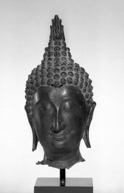 <em>Head of a Buddha</em>, 14th-16th century. Bronze, 11 1/2 x 5 x 6 in. (29.2 x 12.7 x 15.3 cm). Brooklyn Museum, Gift of Mr. and Mrs. Paul E. Manheim, 69.125.6. Creative Commons-BY (Photo: Brooklyn Museum, 69.125.6_bw.jpg)