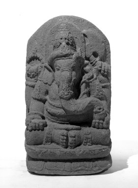 <em>Seated Four Armed Ganesha</em>, ca. 9th-10th century. Volcanic stone, 22 7/16 x 13 in. (57 x 33 cm). Brooklyn Museum, Gift of Mr. and Mrs. Paul E. Manheim, 69.125.7. Creative Commons-BY (Photo: Brooklyn Museum, 69.125.7_bw.jpg)