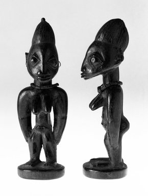 Yorùbá artist. <em>Female twin figure (Ère Ìbejì)</em>, 19th or 20th century. Wood, pigment, 10 13/16 in.  (27.4 cm). Brooklyn Museum, Gift of Merton D. Simpson to the Jennie Simpson Educational Collection of African Art, 69.133.10. Creative Commons-BY (Photo: , 69.133.9_69.133.10_bw.jpg)