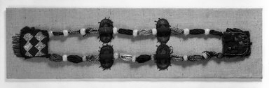 Yorùbá. <em>Ifá diviner's necklace (òdìgbà Ifá)</em>, late 19th century. Glass beads, felt, fiber, leather, strap: 34 3/8 x 37 in. pouches: 6 1/2 x 5 1/2 and 6 x 5 5/8 in. Brooklyn Museum, Caroline A.L. Pratt Fund, 69.134. Creative Commons-BY (Photo: Brooklyn Museum, 69.134_bw.jpg)