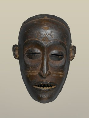 Chokwe. <em>Mask (Mwana Pwo)</em>, 19th century. Wood, 7 1/2 x 3 1/8 x 5 1/2 in. (19.1 x 8 x 14 cm). Brooklyn Museum, Gift of Mr. and Mrs. John McDonald, 69.168.2. Creative Commons-BY (Photo: Brooklyn Museum, 69.168.2_PS2.jpg)