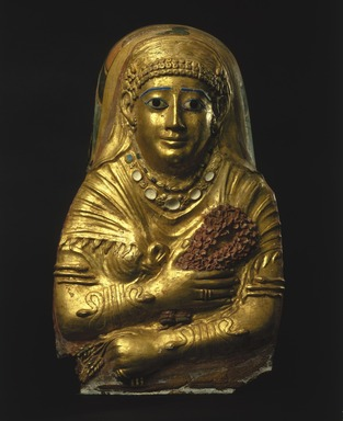 <em>Mummy Cartonnage of a Woman</em>, 1st century C.E. Linen, gesso, gold leaf, glass, faience, 23 x 14 x 9 in. (58.4 x 35.6 x 22.9 cm). Brooklyn Museum, Charles Edwin Wilbour Fund, 69.35. Creative Commons-BY (Photo: Brooklyn Museum, 69.35_SL1.jpg)