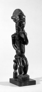 Baule. <em>Male Figure Seated on a Stool</em>, late 19th or early 20th century. Wood, glass beads, 19 x 4 3/4 x 4 1/2 in. (48.3 x 12.1 x 11.4 cm). Brooklyn Museum, By exchange, 69.39.4. Creative Commons-BY (Photo: Brooklyn Museum, 69.39.4_threequarter_bw.jpg)