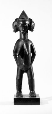 Guro. <em>Standing Female Figure With Three Faces</em>, late 19th-early 20th century. Wood, height: 17 5/16 in. (44.0 cm). Brooklyn Museum, Robert B. Woodward Memorial Fund and Gift of Arturo and Paul Peralta-Ramos, by exchange, 69.39.5. Creative Commons-BY (Photo: Brooklyn Museum, 69.39.5_front_bw.jpg)
