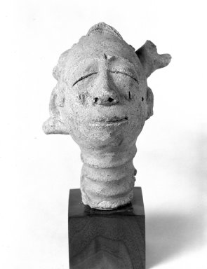 Anyi. <em>Funerary Head (Mma)</em>, 18th-19th century. Terracotta, 6 1/8 in. (15.5 cm). Brooklyn Museum, Gift of Dr. and Mrs. Abbott A. Lippman, 69.56. Creative Commons-BY (Photo: Brooklyn Museum, 69.56_bw.jpg)