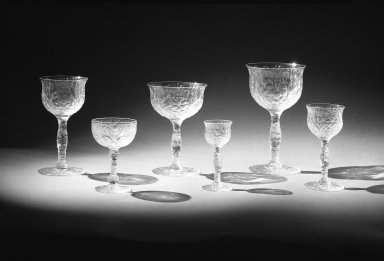 Libbey Glass Company (founded 1888). <em>Water Goblet</em>, ca. 1904. Glass, 6 9/16 x 4 11/16 x 3 3/16 in. (16.7 x 11.9 x 8.1 cm). Brooklyn Museum, Gift of the Toledo Museum of Art and Owens-Illinois, Inc., 69.76.1. Creative Commons-BY (Photo: , 69.76.1-.6_bw.jpg)