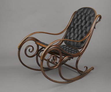 Michael Thonet (1796-1871). <em>Rocking Chair, Model #1</em>, Designed ca. 1860, manufactured ca. 1900. Copper beech, leather, 39 1/4 x 22 1/2 x 45 in. (99.7 x 57.2 x 114.3 cm). Brooklyn Museum, Caroline A.L. Pratt Fund, 69.79.1. Creative Commons-BY (Photo: Brooklyn Museum, 69.79.1_threequarter_PS6.jpg)